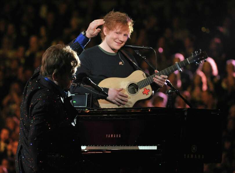 Sir Elton John, left, and Ed Sheeran perform on stage at the 55th annual Grammy Awards on Sunday, Fe