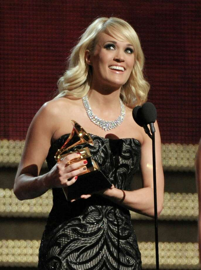 Carrie Underwood accepts the award for best country solo performance for Blown Away at the 55th annual Grammy Awards on Sunday, Feb. 10, 2013, in Los Angeles. (Photo by John Shearer/Invision/AP) Photo: John Shearer, Associated Press / Invision