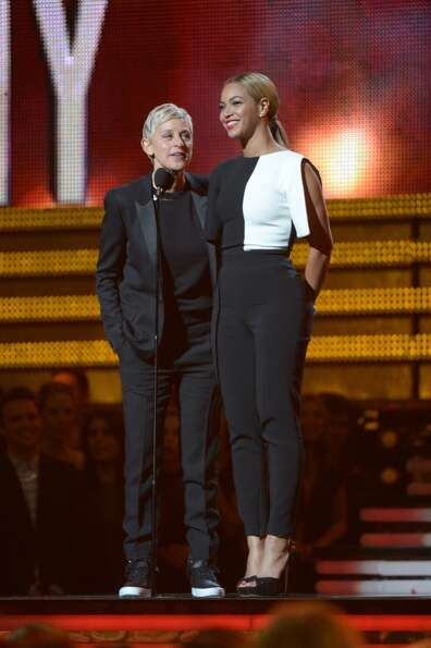 Ellen DeGeneres and Beyonce speak on the stage at the Staples Center during the 55th Grammy Awards i