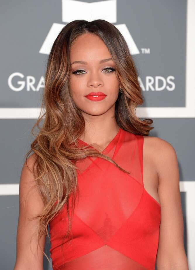 Singer Rihanna arrives at the 55th Annual GRAMMY Awards at Staples Center on February 10, 2013 in Los Angeles, California. Photo: Jason Merritt, Getty Images / 2013 Getty Images