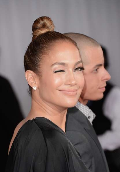 Singer Jennifer Lopez (L) and dancer Casper Smart arrive at the 55th Annual GRAMMY Awards at Staples