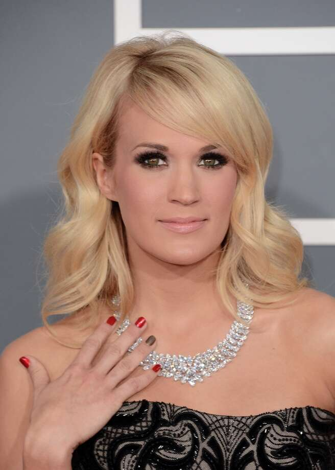 Singer Carrie Underwood arrives at the 55th Annual GRAMMY Awards at Staples Center on February 10, 2013 in Los Angeles, California. Photo: Jason Merritt, Getty Images / 2013 Getty Images