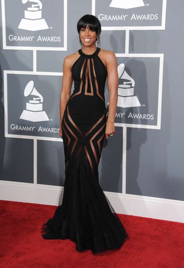 Kelly Rowland arrives at the 55th annual Grammy Awards wearing a dress from the Georges Chakra Couture Collection on Sunday, Feb. 10, 2013, in Los Angeles. (Photo by Jordan Strauss/Invision/AP) Photo: Jordan Strauss, Associated Press / Invision