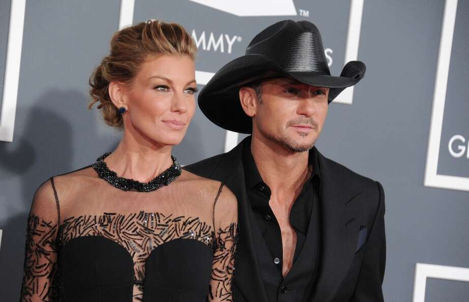 Faith Hill, left, and Tim McGraw arrive at the 55th annual Grammy Awards on Sunday, Feb. 10, 2013, i