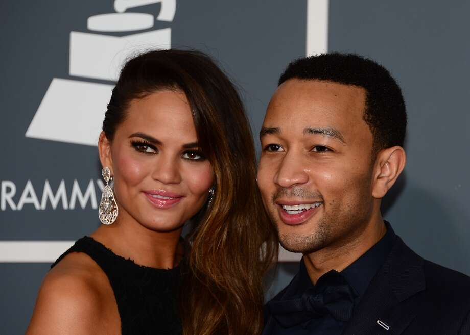 Musician John Legend and Chrissy Teigen arrive on the red carpet at the Staples Center for the 55th Grammy Awards in Los Angeles, California, February 10, 2013. AFP PHOTO Frederic J. BROWNFREDERIC J. BROWN/AFP/Getty Images Photo: FREDERIC J. BROWN, AFP/Getty Images / AFP