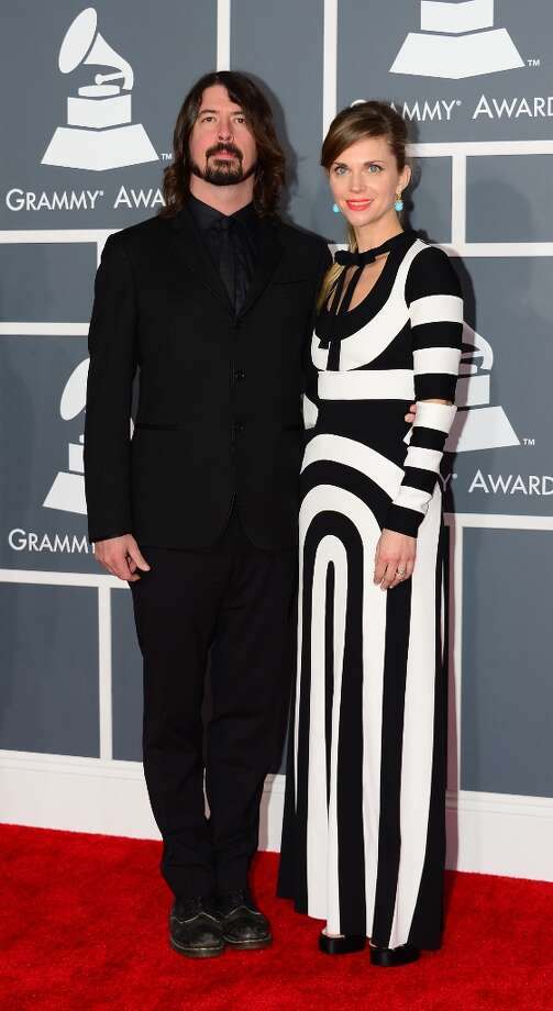 Dave Grohl and his wife Jordyn arrive on the red carpet at the Staples Center for the 55th Grammy Awards in Los Angeles, California, February 10, 2013. AFP PHOTO Frederic J. BROWN Photo: FREDERIC J. BROWN, AFP/Getty Images / AFP