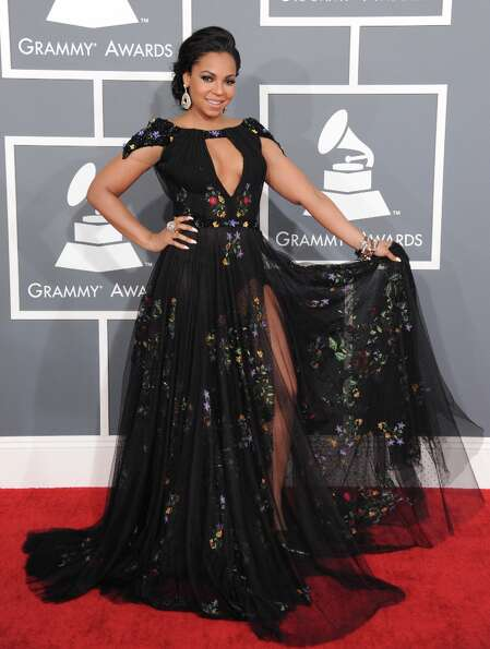 Ashanti arrives at the 55th annual Grammy Awards on Sunday, Feb. 10, 2013, in Los Angeles.  (Photo b