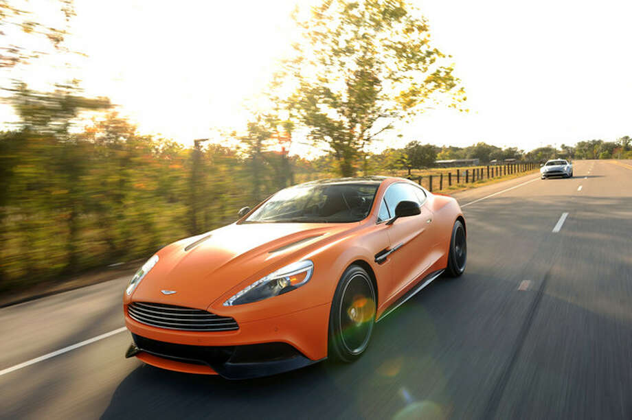 A 2014 Aston Martin Vanquish. The 6-liter V-12 engine boasts 565 horsepower and 457 pounds per foot of torque.