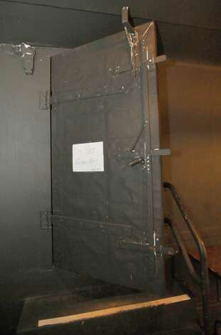 "One of two entrances to the basement area is in the orchestra pit in front of the stage. These big fire doors will close on the entrances if needed. Right past this entrance are dressing rooms which are under the stage itself. Every town has them, known as ""secret places,"" and they are usually off limits to the general public. You may have heard of them, wondered about them, but have never seen them, or you may not realize they exist at all.  One such place is the basement of the Jefferson Theater, where tunnel like walkways that were built originally as giant air ducts for the refrigerated air in one of the city's first buildings with central heat and air, still exist along with other small rooms. Dave Ryan/The Enterprise"