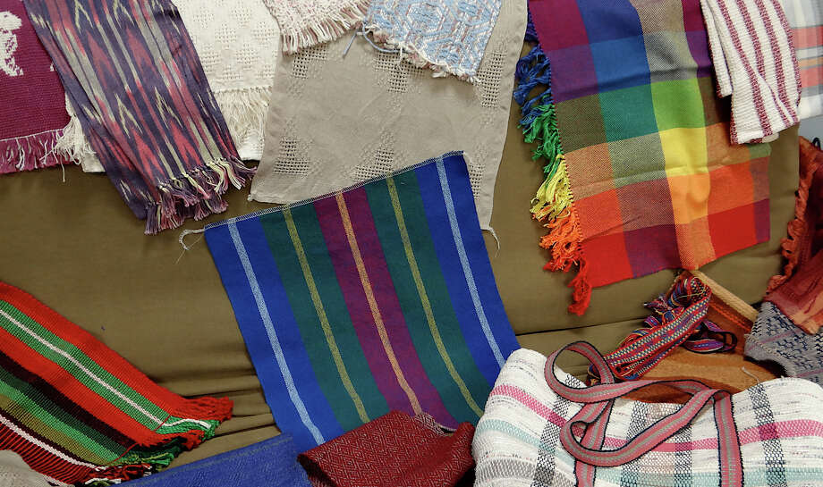 Towels, belts and totes made by members of the Handweavers Guild of Connecticut were displayed Saturday when guild members led a workshop at the Fairfield Woods Branch Library.   FAIRFIELD CITIZEN, CT 2/2/13 Photo: Mike Lauterborn / Fairfield Citizen contributed