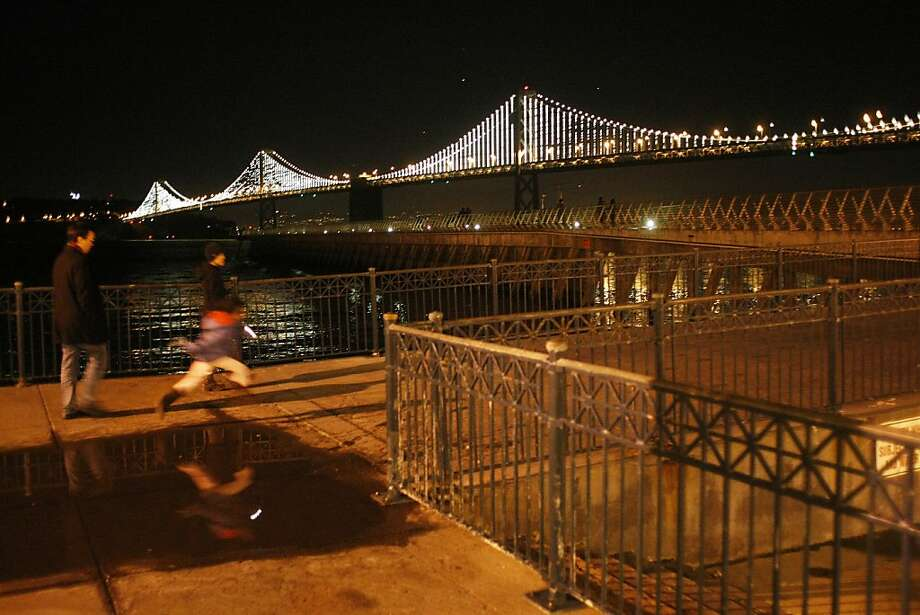 From Pier 14, a view of the light show that will illuminate the Bay Bridge on March 5. Photo: James Tensuan, The Chronicle