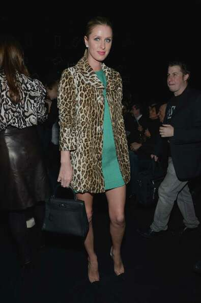 Nicky Hilton attends the Diane Von Furstenberg Fall 2013 fashion show during Mercedes-Benz Fashion a