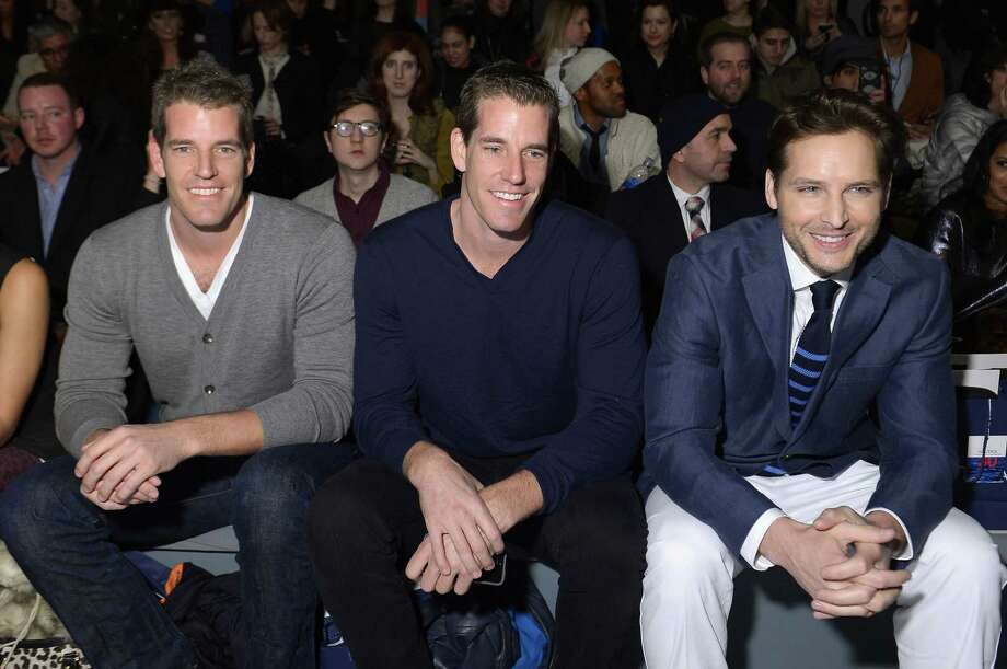 Tyler Winklevoss, Cameron Winklevoss, and actor Peter Facinelli attend the Nautica Men's Fall 2013 fashion show during Mercedes-Benz Fashion Week at The Stage at Lincoln Center on February 8, 2013 in New York City.  (Photo by Michael Loccisano/Getty Images for Mercedes-Benz Fashion Week) Photo: Michael Loccisano, (Credit Too Long, See Caption) / 2013 Getty Images