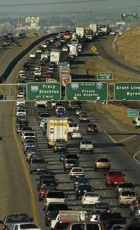Traffic crawls along Interstate 580 in the Altamont Pass hills after a grass fire burning near Livermore, Calif., forced authorities to close the road Tuesday, July 11, 2006. (AP Photo/Noah Berger) Ran on: 07-12-2006 Traffic crawls on I-580 along the Altamont Pass after a fire near Livermore forced authorities to close a section of the road. Ran on: 07-12-2006  Ran on: 07-12-2006  Ran on: 07-12-2006 Traffic crawls on Interstate 580 along the Altamont Pass after a fire forced closure of the road. Photo: Noah Berger, AP