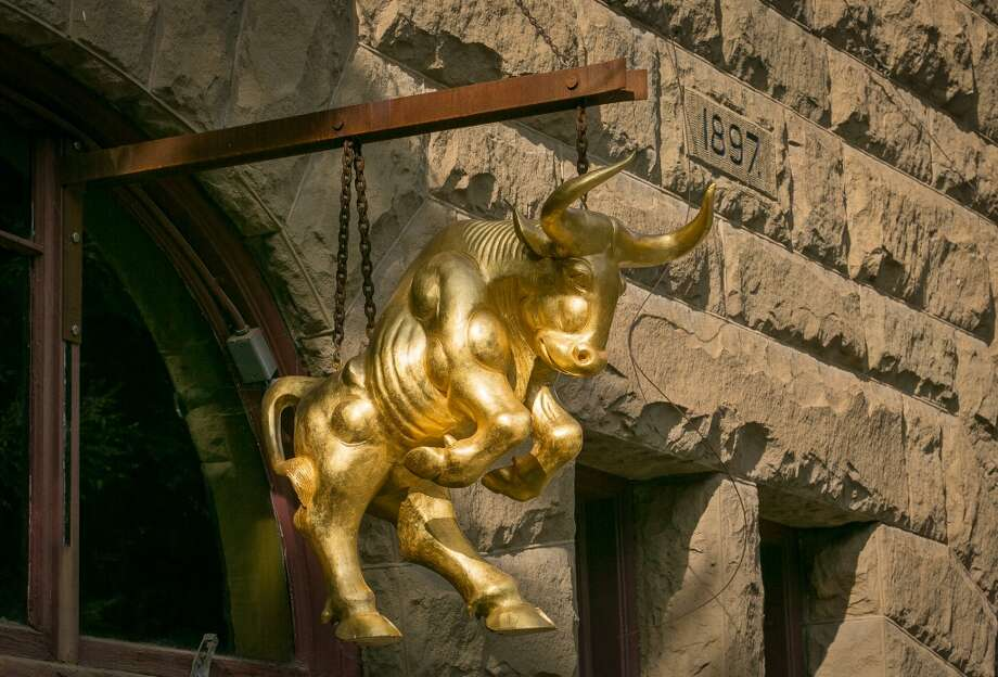 The entrance of Bull Valley Roadhouse is marked by a golden ox that hangs over the door...