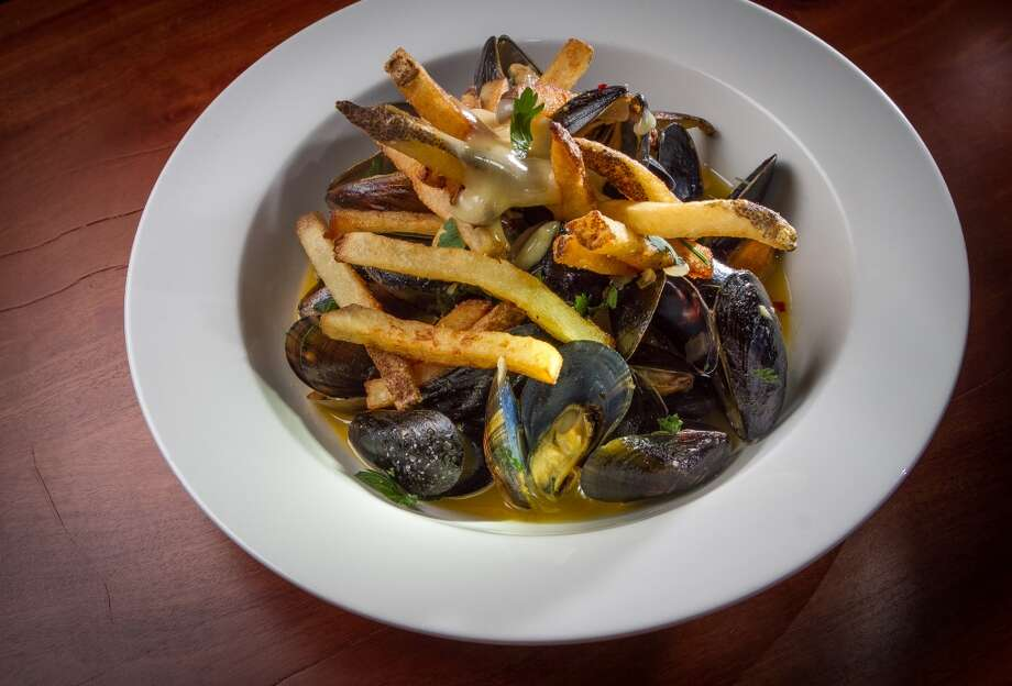 Even the presentations of the family-style dishes seem to mimic what one might imagine a boardinghouse might have served. A heaping bowl of PEI mussels ($15) in a deeply flavored sauce fortified with white wine and shallots is crowned with a haystack of thick fries so crisp you'd swear they were fried three times, and a creamy aioli so infused with garlic it stings the back of the throat. It's a magical blend that wakes up the palate.