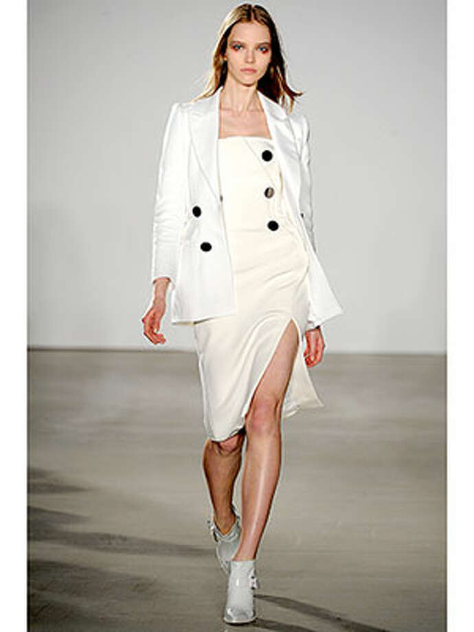 Altuzarra  The modern woman would do well to take loads of inspiration from this Altuzarra collection. We want to see this white suit on Scandal's Olivia Pope immediately. Photo: Catwalking, Www.cosmopolitan.com  / 2013 Catwalking