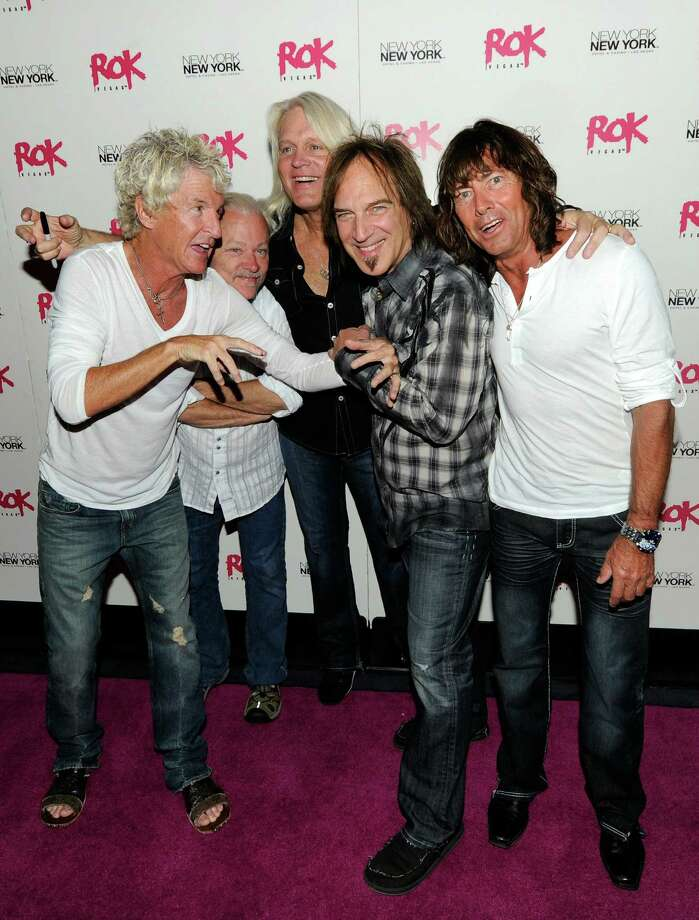 LAS VEGAS - JULY 24:  REO Speedwagon (L-R) frontman Kevin Cronin, keyboardist Neal Doughty, bassist Bruce Hall, guitarist Dave Amato and drummer Bryan Hitt arrive at an after-concert party at the Rok Vegas nightclub at the New York-New York Hotel & Casino early July 24, 2010 in Las Vegas, Nevada.  (Photo by Ethan Miller/Getty Images for Rok Vegas Nightclub) Photo: Ethan Miller / 2010 Getty Images