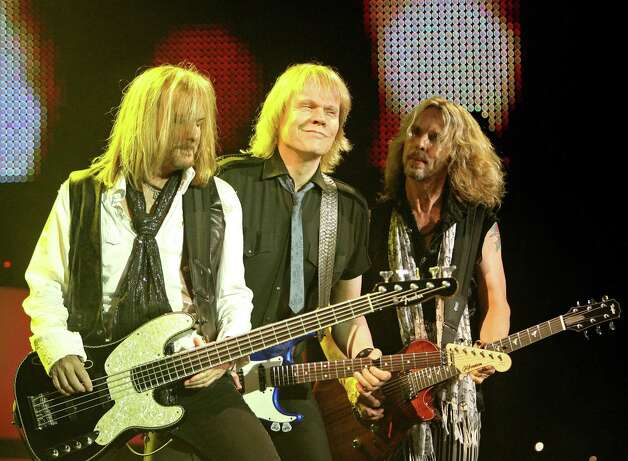 "Styx band members, left to right, Ricky Phillips, James ""J.Y."" Young and Tommy Shaw perform during their ""Can't Stop Rockin"" tour stop Sunday, June 7, 2009 at the Cynthia Woods Mitchell Pavilion in The Woodlands, Texas. (AP Photo/The Courier, Eric S. Swist) Photo: Eric S. Swist / The Courier"