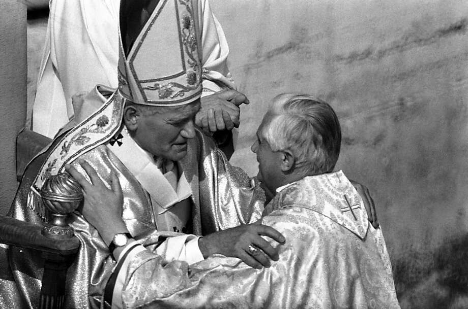 Pope John Paul II (left) greets future Pope Benedict XVI. Photo: Anonymous, Associated Press