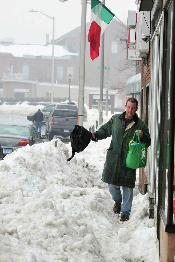 Dennis Taylor makes his way along the sidewalk on White Street in Danbury Monday, Feb. 11, 2012. Photo: Michael Duffy / The News-Times