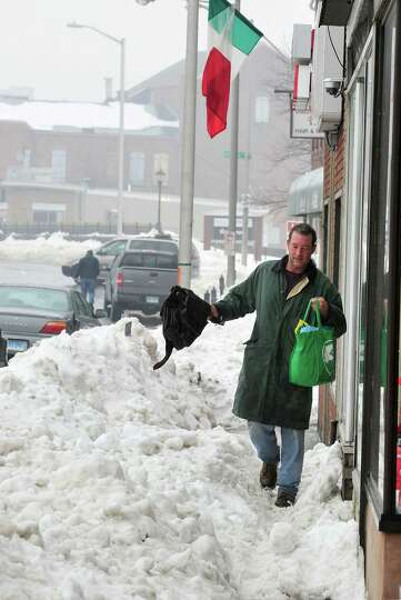 Dennis Taylor makes his way along the sidewalk on White Street in Danbury Monday, Feb. 11, 2012.