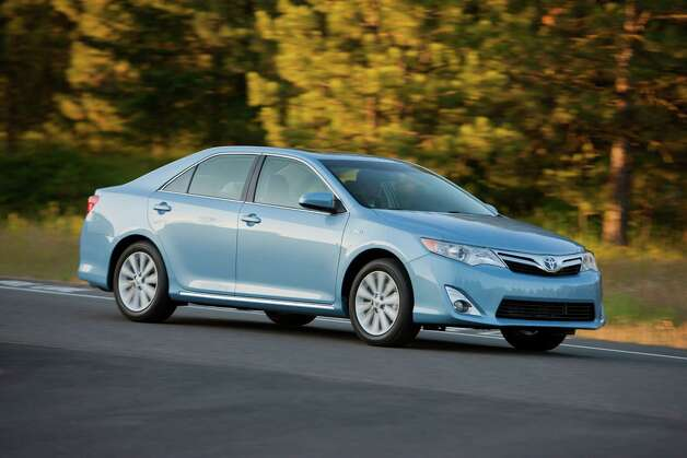 "Toyota Camry Hybrid: Toyota's strong reputation helped give it the top three hybrids ranked by consumers. The Camry gives drivers plenty of performance and outstanding fuel economy. What Edmunds says: ""The 2012 Toyota Camry Hybrid is a solid hybrid family sedan thanks to improved fuel economy and enhanced driving dynamics.""