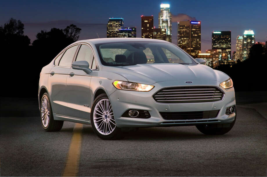 """Ford Fusion Hybrid: The Fusion takes some of its styling cues from the Aston Martin but for much less. The car is packed with high-tech gadgets to give it an edge on the road. What Edmunds says: """"With added refinement and technology, the 2013 Fusion Hybrid could take Ford to the top of the class for hybrid sedans.""""Price: $24,200MPG: 47 city/47 highwaySource: Edmunds / Ford"""
