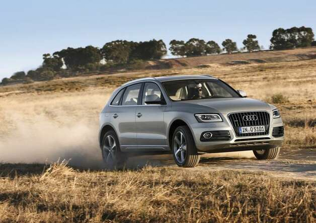 "Audi Q5 Hybrid: This crossover will give you top-notch interior with class-leading fuel economy. What Edmunds says: ""From exciting performance to excellent comfort and convenience, the 2013 Audi Q5's qualities give it broad appeal.""