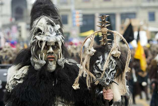 The Black Hole of Switzerland: This carnival celebrant in Lucerne is obviously a Raiders fan, with a little bit of Predator and Dr. Seuss thrown in for good measure. Photo: Sigi Tischler, Associated Press