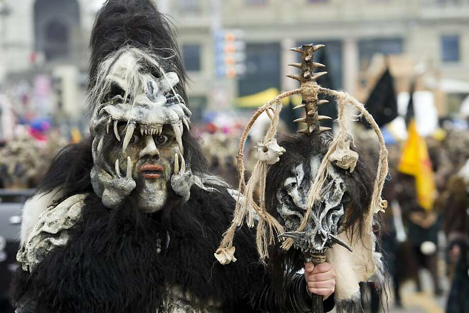 The Black Hole of Switzerland:This carnival celebrant in Lucerne is obviously a Raiders fan, with a little bit of Predator and Dr. Seuss thrown in for good measure. Photo: Sigi Tischler, Associated Press