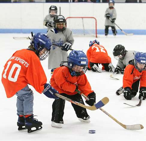 Did someone lose a contact? The stars of the Brainerd Ice Mites in Brainerd, Minn., are the ones that can stand up on their skates. Photo: Kelly Humphrey, Associated Press