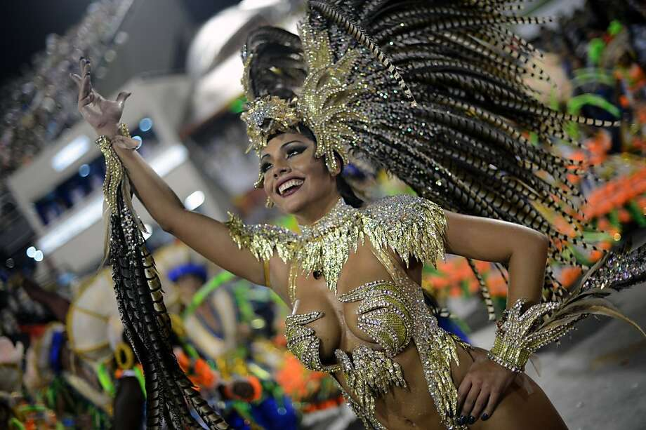 Resplendent in her plumage,a dancer of the Portela samba school waves to the crowd during the first night of carnival parade at the Sambadrome in Rio de Janeiro. Photo: Christophe Simon, AFP/Getty Images