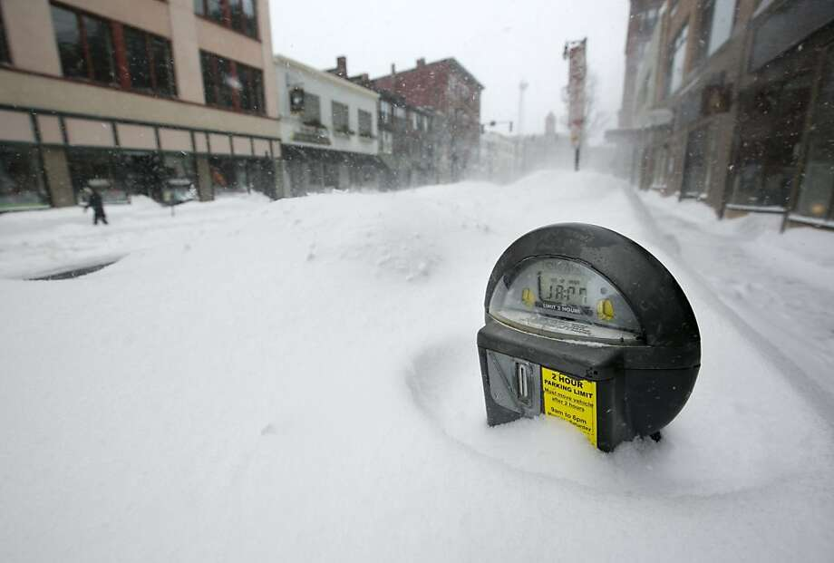 Ay-yah. Now where did I pahk my cah? Drifts nearly cover the tops of parking meters in Portland, Maine, after the biggest snowstorm on record. Photo: Robert F. Bukaty, Associated Press