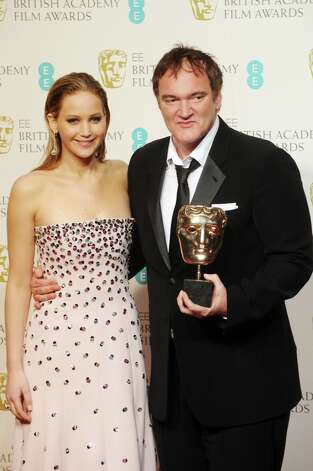 Jennifer Lawrence poses with Quentin Tarantino after presenting him with the Best Original Screenplay Awar at the EE British Academy Film Awards at The Royal Opera House on February 10, 2013 in London, England. Photo: Stuart Wilson, Getty Images / 2013 Getty Images