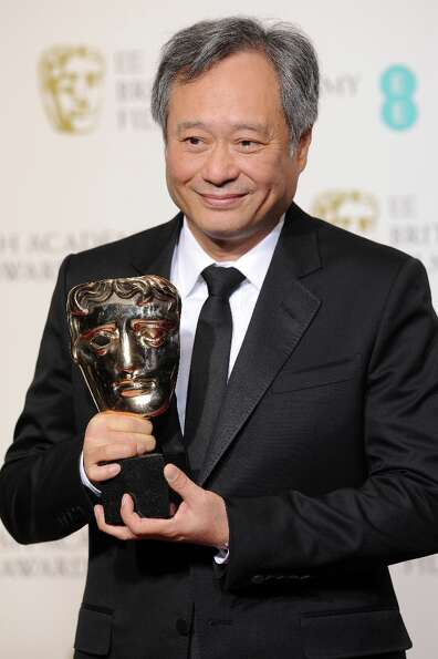 Director Ang Lee  poses in the press room at the EE British Academy Film Awards at The Royal Opera H