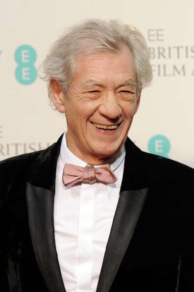 Ian McKellen  poses in the press room at the EE British Academy Film Awards at The Royal Opera House