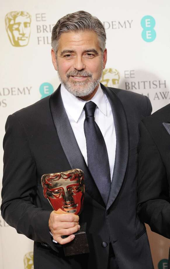 George Clooney, winner of the Best Film award for Argo, poses in the press room at the EE British Academy Film Awards at The Royal Opera House on February 10, 2013 in London, England. Photo: Stuart Wilson, Getty Images / 2013 Getty Images