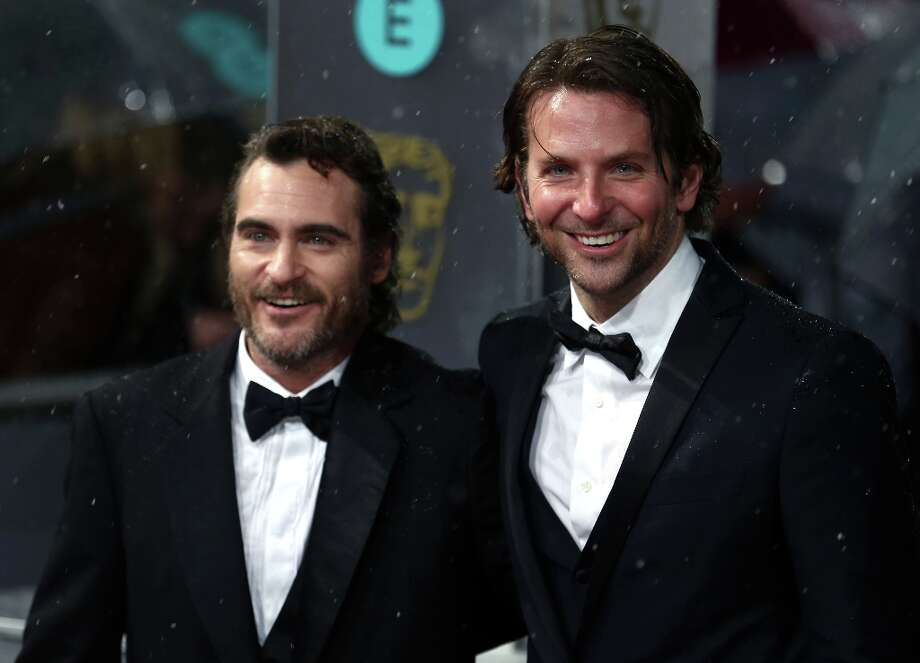 US actors Bradley Cooper (R) and Joaquin Phoenix pose on the red carpet upon arrival to attend the annual BAFTA British Academy Film Awards at the Royal Opera House in London on February 10, 2013.  AFP PHOTO/ANDREW COWIE Photo: ANDREW COWIE, AFP/Getty Images / AFP