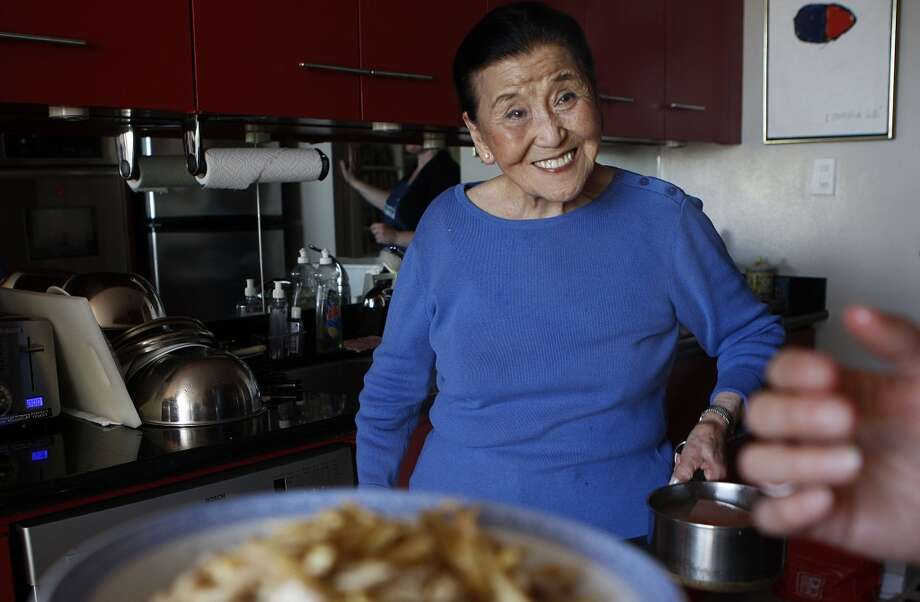 Cecilia Chiang showing Janny Hu how to make recipes for Chinese New Year at her home in San Francisco.