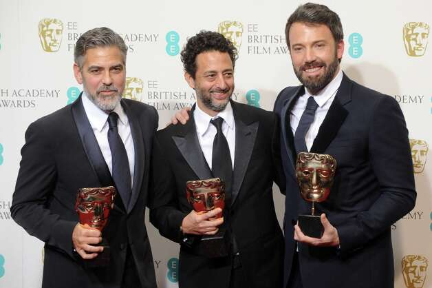 (L-R) George Clooney, Grant Heslov and Ben Affleck, winners of the Best Film award for Argo, pose in the press room at the EE British Academy Film Awards at The Royal Opera House on February 10, 2013 in London, England. Photo: Stuart Wilson, Getty Images / 2013 Getty Images