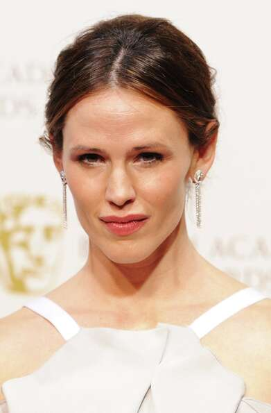 Presenter Jennifer Garner poses in the press room at the EE British Academy Film Awards at The Royal