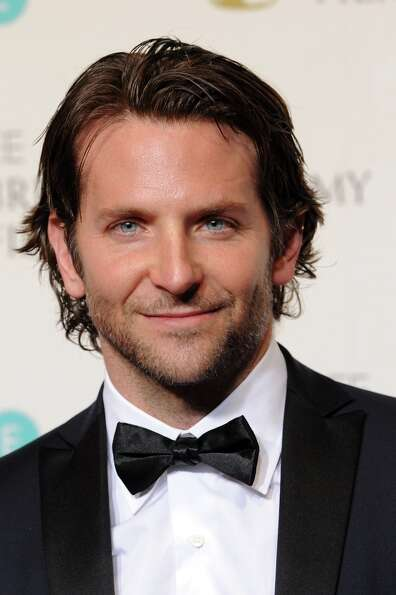Presenter Bradley Cooper Bradley Cooperposes in the press room at the EE British Academy Film Awards