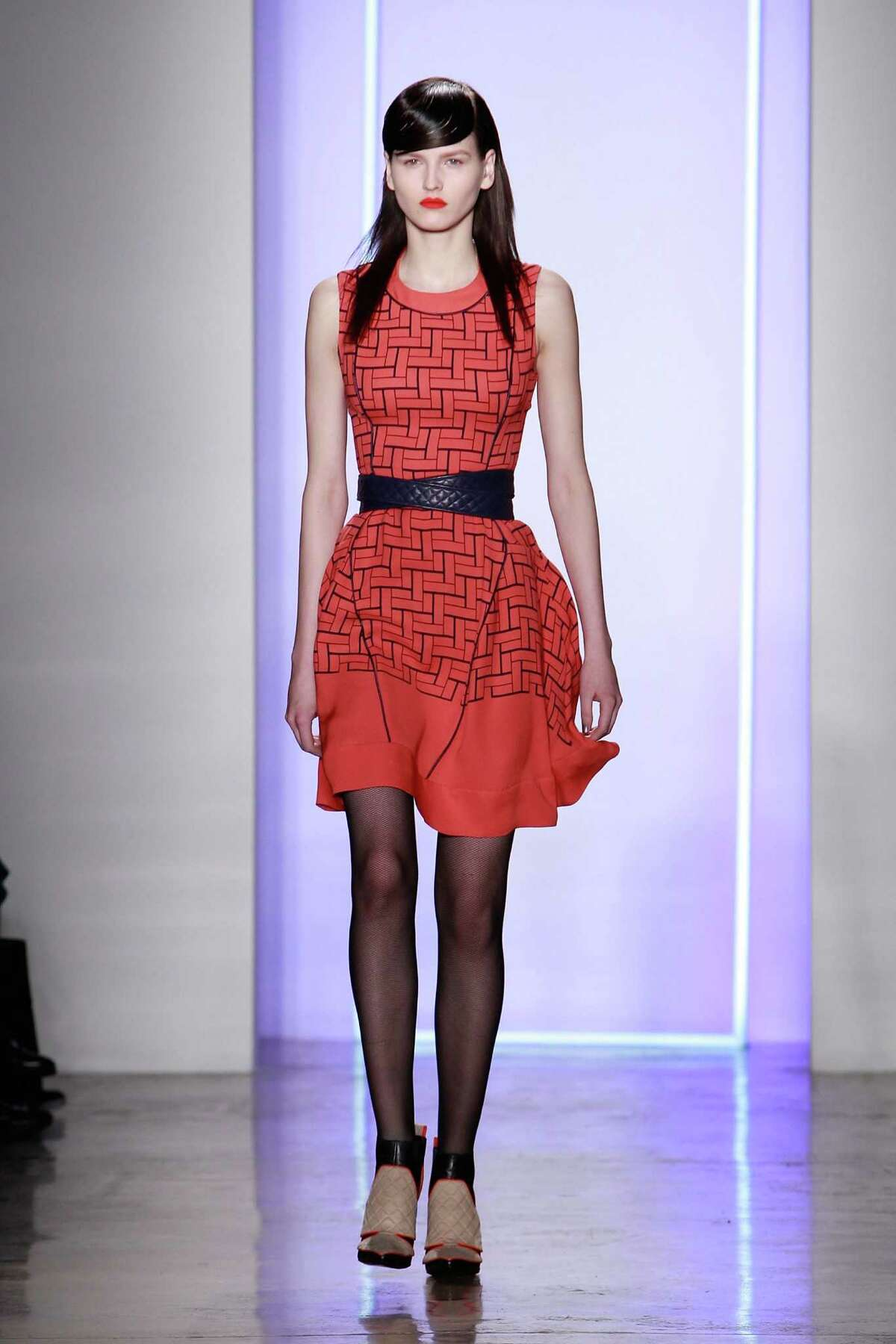 A model walks the runway at the Ohne Titel fall 2013 fashion show during MADE Fashion Week at Milk Studios on February 11, 2013 in New York City.