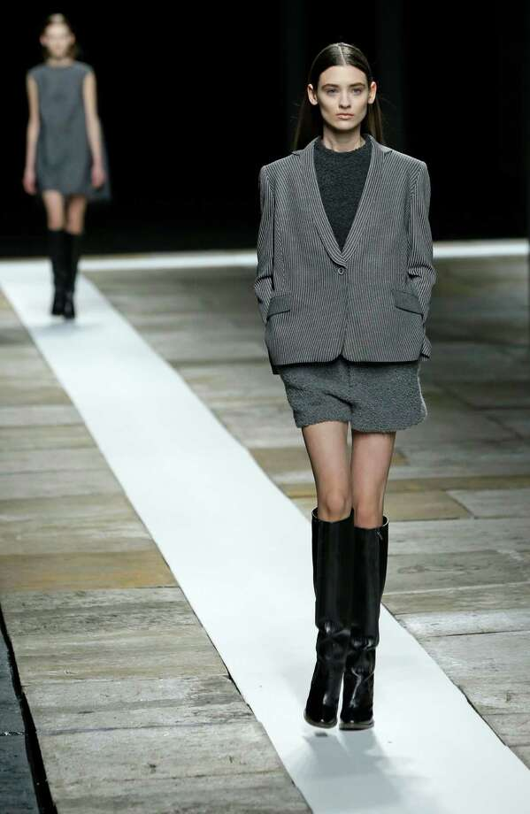 Models walk the runway during the Theyskens Theory Fall 2013 show at Fashion Week in New York, Monday, Feb. 11, 2013.  Photo: Kathy Willens, Associated Press / AP