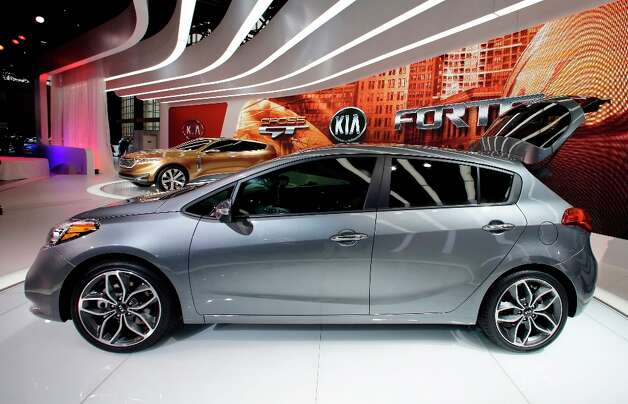 Kia's 2014 Forte5-Door car is on display during the media preview of the Chicago Auto Show at McCormick Place in Chicago on Thursday, Feb. 7, 2013.  (AP photo/Nam Y. Huh) Photo: Nam Y. Huh, Associated Press / AP