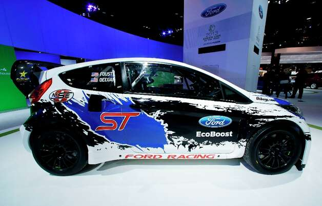 A Ford Fiesta ST  is on display during the media preview of the Chicago Auto Show at McCormick Place in Chicago on Thursday, Feb. 7, 2013.  (AP photo/Nam Y. Huh) Photo: Nam Y. Huh, Associated Press / AP
