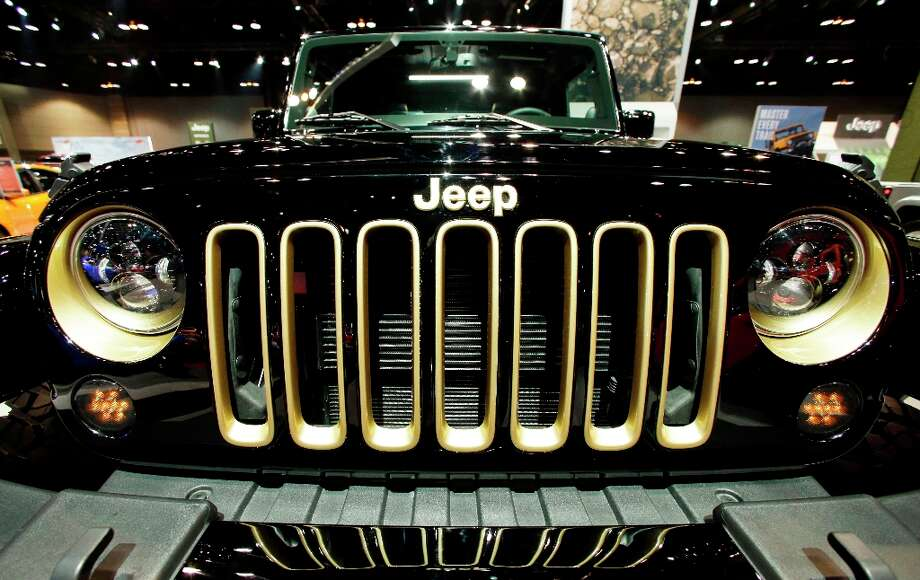 A Jeep Wrangler is on display during the media preview of the Chicago Auto Show at McCormick Place in Chicago on Thursday, Feb. 7, 2013.  (AP photo/Nam Y. Huh) Photo: Nam Y. Huh, Associated Press / AP