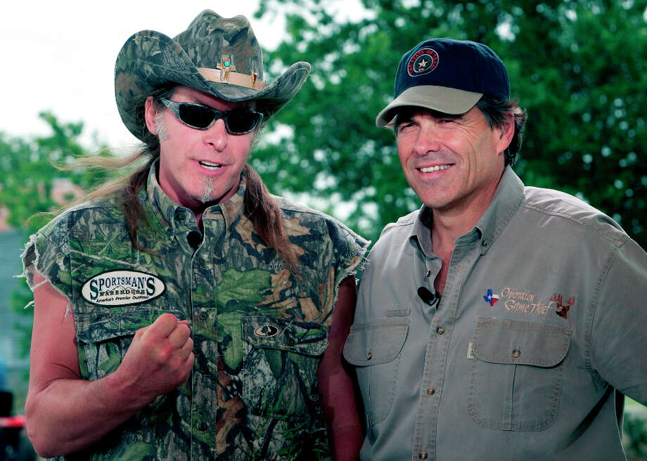 ** FILE ** In this file photo, rock musician Ted Nugent, left, and Texas Gov. Rick Perry, right, speak during an appearance on national television in Crawford, Texas, Saturday, June 4, 2005. Hours after Gov. Rick Perry kicked off his second full term in office on Wednesday, Jan. 17, 2007, rocker Ted Nugent helped him celebrate at a black-tie gala, but not all attendees were pleased by the performance. Using machine guns as props, Nugent appeared onstage as the final act of the inaugural ball wearing a cut-off T-shirt emblazoned with the Confederate flag and shouting offensive remarks about non-English speakers, according to people who were in attendance. Photo: AP / AP