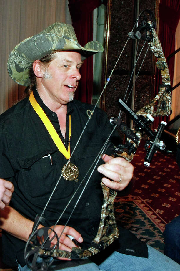 LAS VEGAS - FEBRUARY 06:  Music artist Ted Nugent autographs a bow after he was inducted into the National Bowhunters Hall of Fame during the National Field Archery Association's World Archery Festival at the Riviera Hotel & Casino February 6, 2009 in Las Vegas, Nevada. Nugent was inducted in the Excellence in Bowhunting and Literary Excellence categories. Photo: Ethan Miller, Getty Images / Getty Images North America